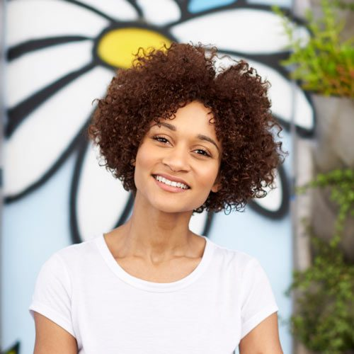 outdoor-head-and-shoulders-portrait-of-smiling-GWFXMSP.jpg